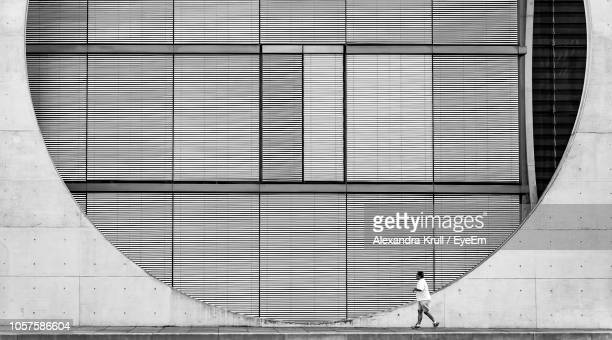Full Length Of Man Walking By Building