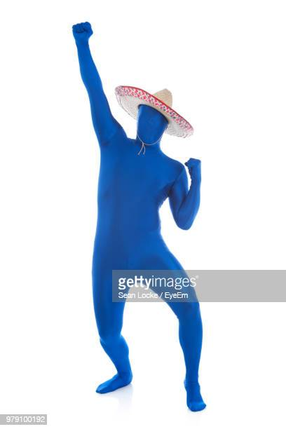 full length of man wearing blue bodysuit against white background - bodysuit stock pictures, royalty-free photos & images