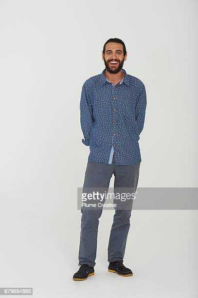 Full length of portrait of man in studio