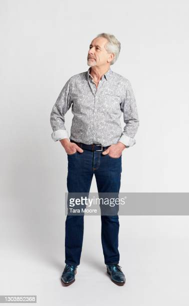 full length of senior man against white background - only men stock pictures, royalty-free photos & images
