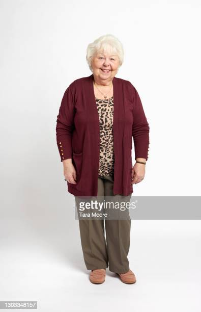 full length of senior woman smiling - full length stock pictures, royalty-free photos & images