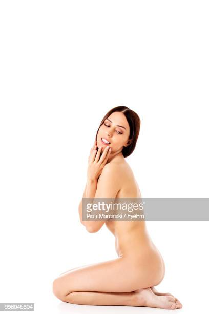 full length of sensuous woman sitting on white background - beautiful bare bottoms stock pictures, royalty-free photos & images