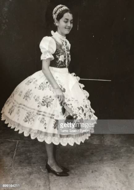 full length of smiling girl in hungarian traditional costume - ハンガリー ストックフォトと画像