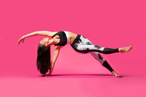 Full Length Of Woman Doing Yoga On Pink Background - gettyimageskorea