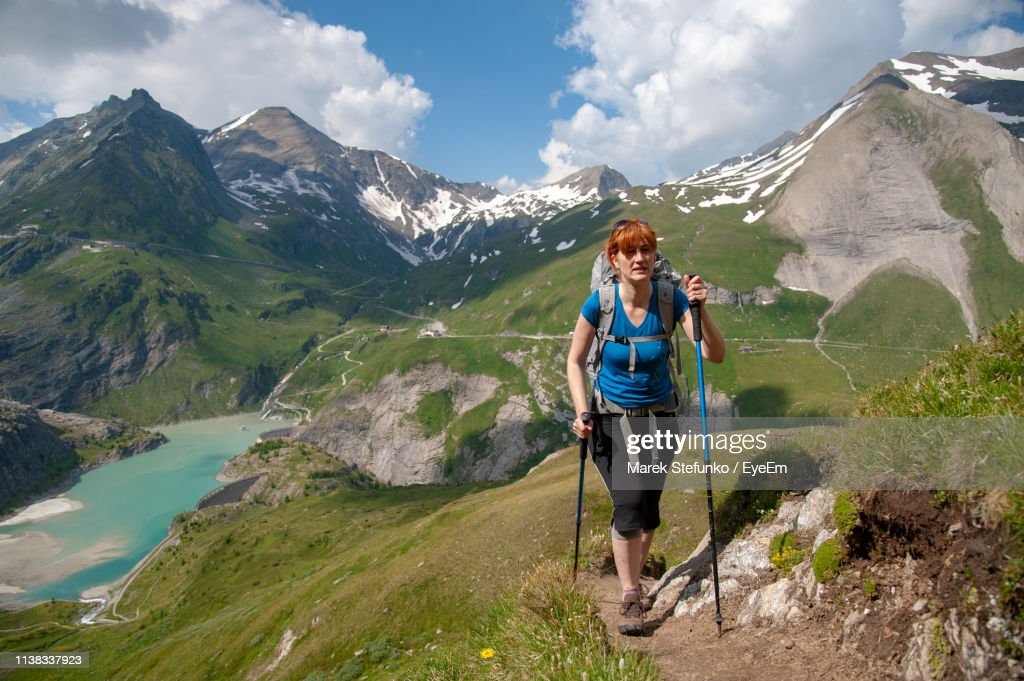 Full Length Of Woman Hiking On Mountain Against Sky : Stock Photo