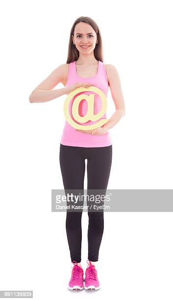 Full Length Of Woman Holding At Symbol Against White Background