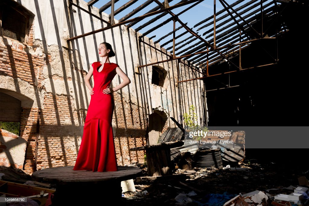 Full Length Of Woman In Dress Standing On Table In Abandoned Building High Res Stock Photo Getty Images