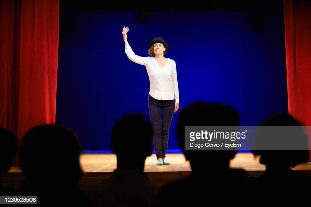 full length of woman performing on stage - actor stock pictures, royalty-free photos & images