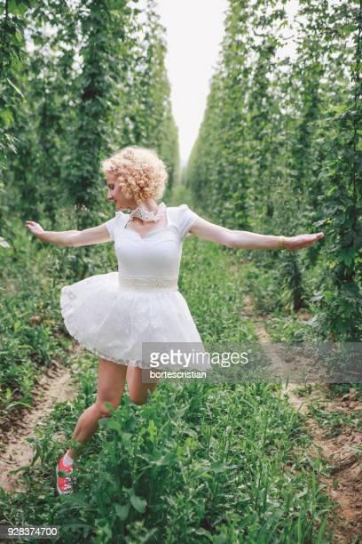 Full Length Of Woman Running On Plants