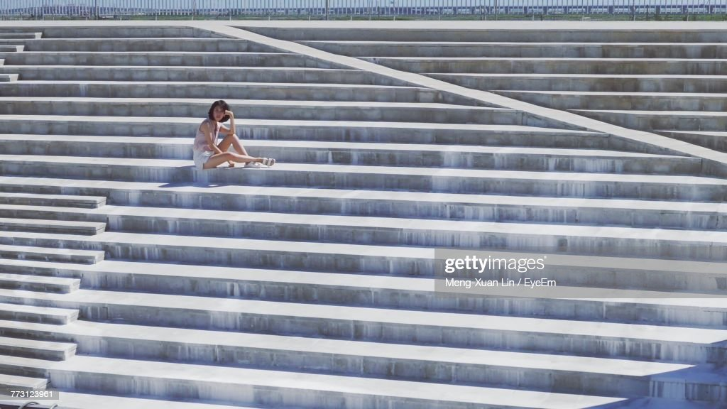 Full Length Of Woman Sitting On Steps : Photo