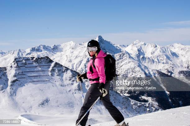 Full Length Of Woman Skiing On Mountain