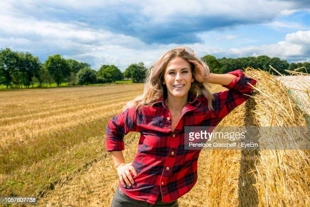 Full Length Of Woman Standing On Agricultural Field