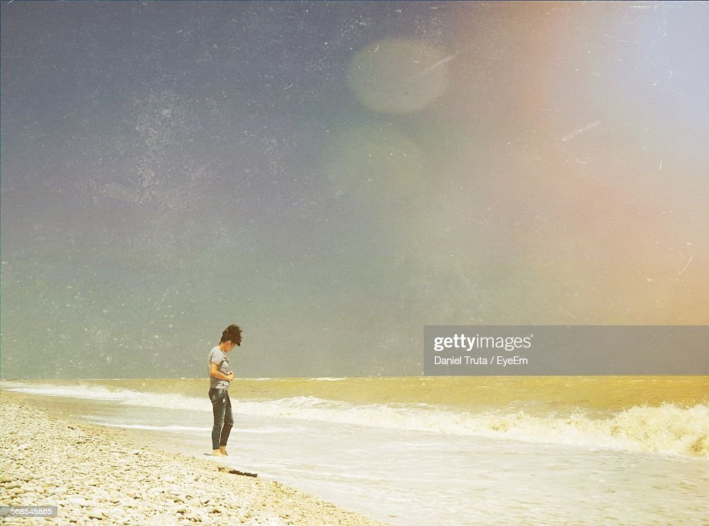 Full Length Of Woman Standing On Beach Against Sky : Stock Photo