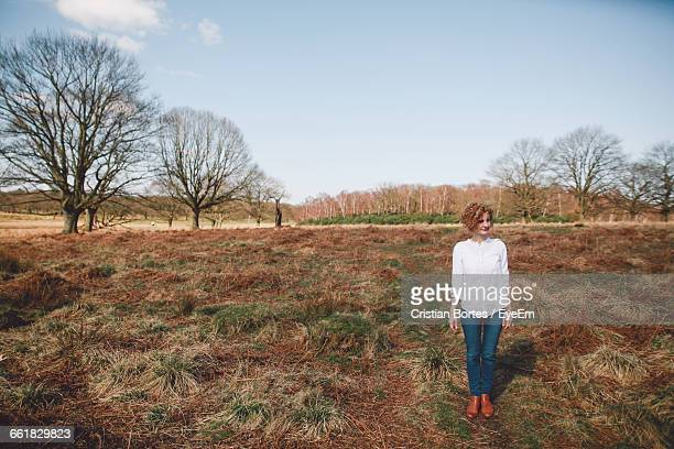 full length of woman standing on field against sky - bortes cristian stock photos and pictures