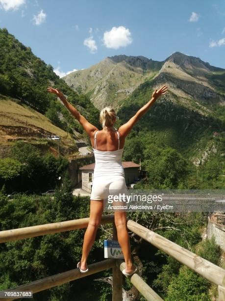 full length of woman standing on mountain against sky - anastasi foto e immagini stock