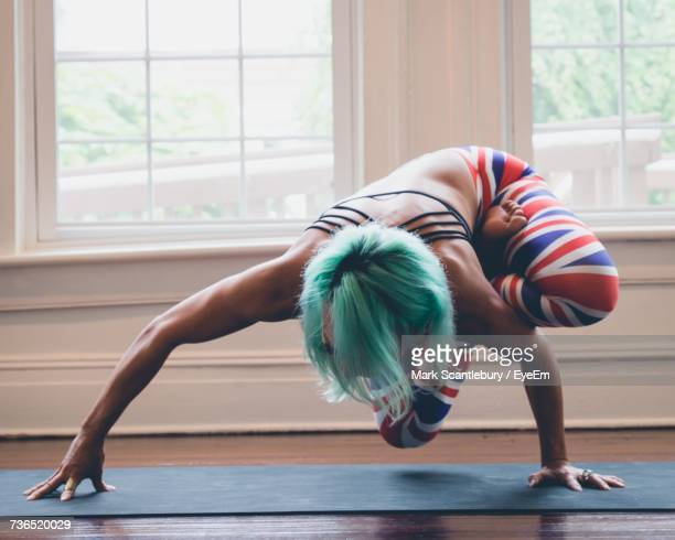 Full Length Of Woman Stretching Against Window