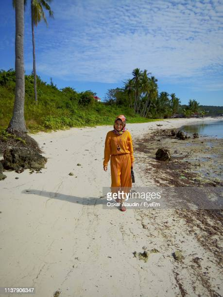full length of woman walking at beach - oskar stock pictures, royalty-free photos & images