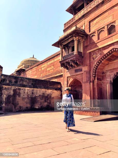Full Length Of Woman Walking At Historical Building