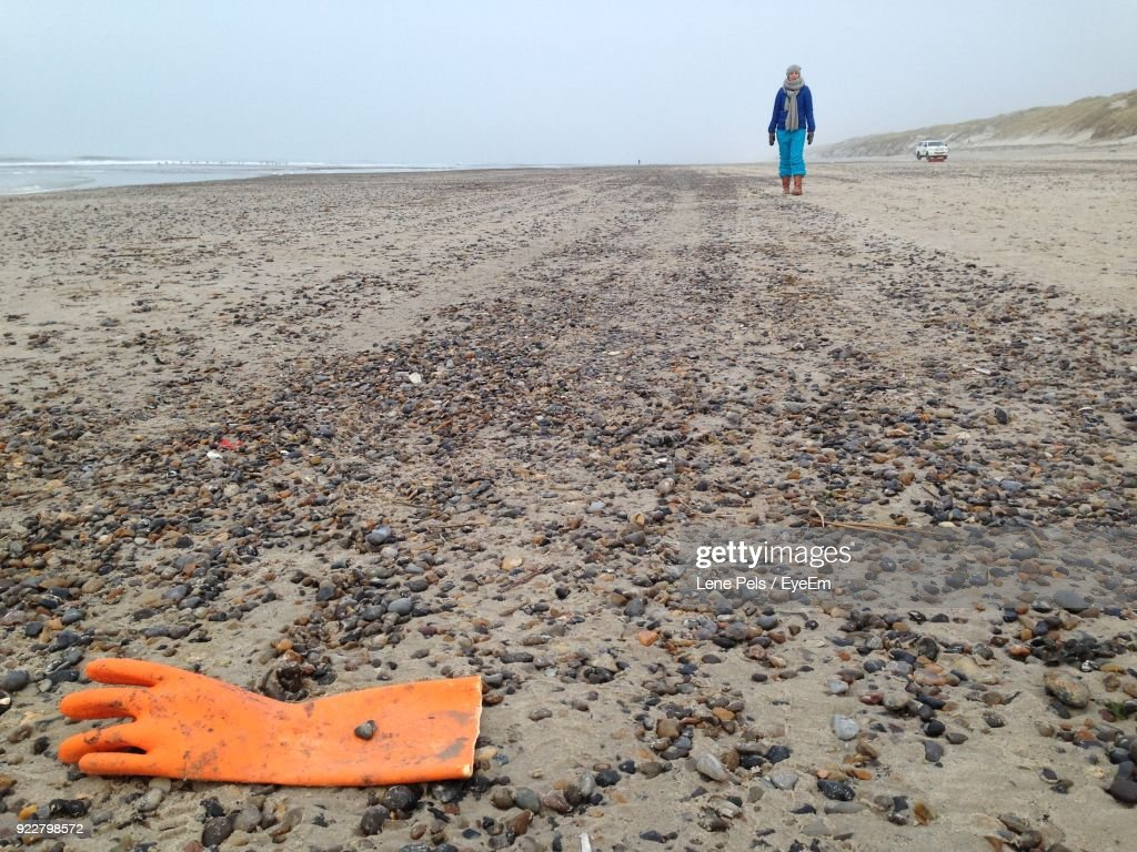 Full Length Of Woman Walking On Sand At Beach : Stock Photo