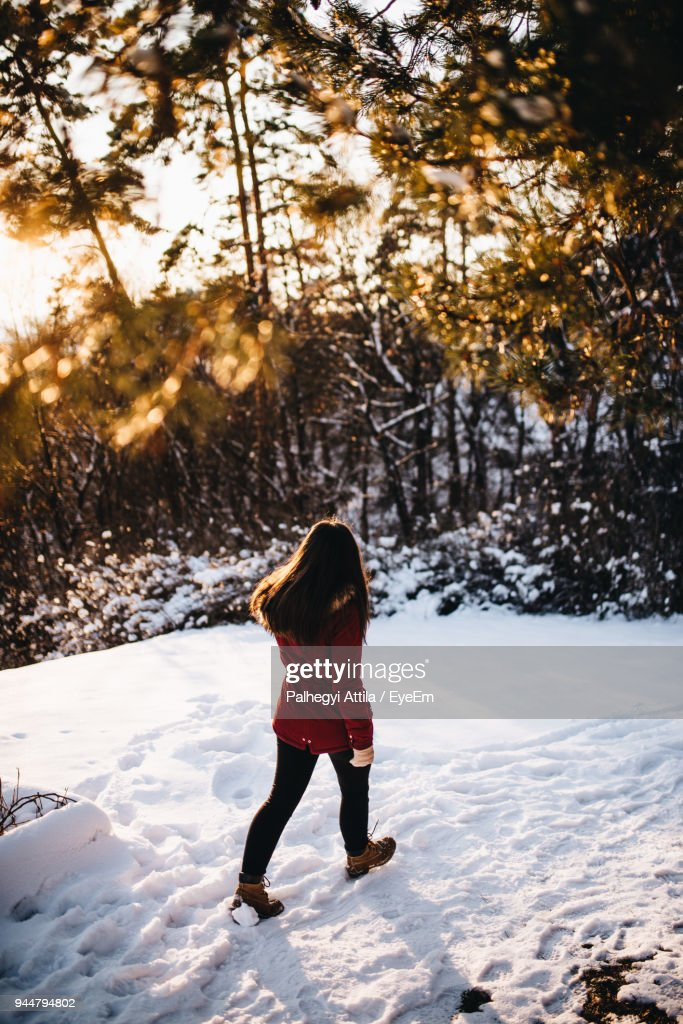 Full Length Of Woman Walking On Snow : Stock Photo