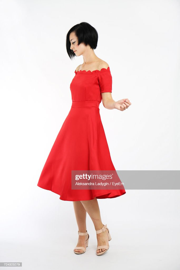 Full Length Of Woman Wearing Dress Against White Background : Stock-Foto