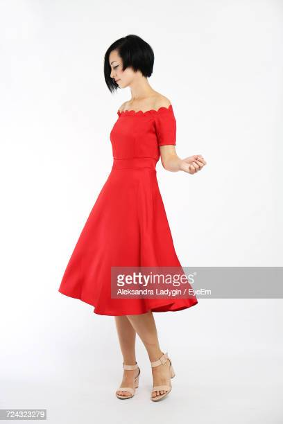 full length of woman wearing dress against white background - cut out dress stock pictures, royalty-free photos & images