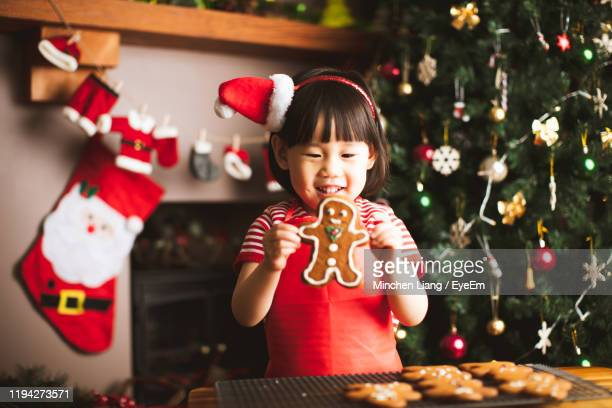 full length of woman with christmas tree - gingerbread men stock pictures, royalty-free photos & images