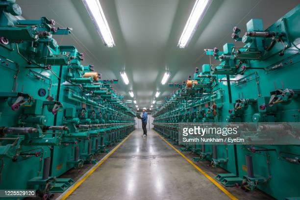 full length of worker working at industry - diminishing perspective stock pictures, royalty-free photos & images