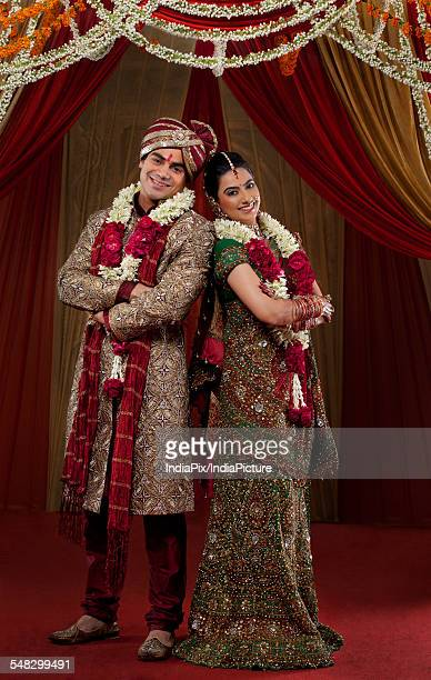 full length of young couple standing - indian wedding stock pictures, royalty-free photos & images