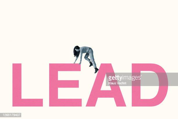 full length of young woman climbing on lead text - pbs stock pictures, royalty-free photos & images