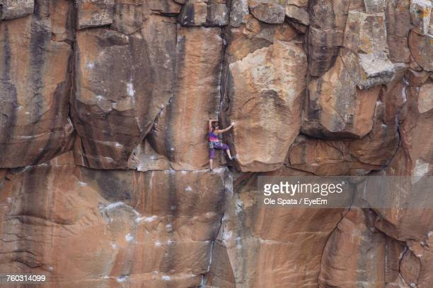 Full Length Of Young Woman On Cliff