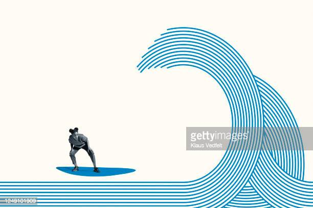 full length of young woman surfing on blue wave - golf sport stockfoto's en -beelden