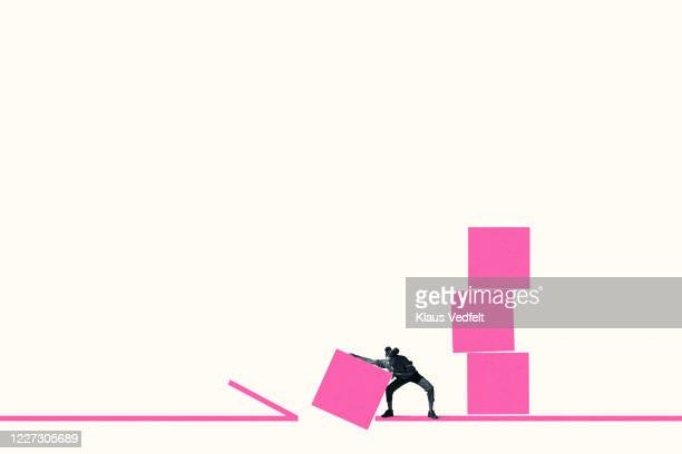 full length of young woman throwing pink block - racism stock pictures, royalty-free photos & images