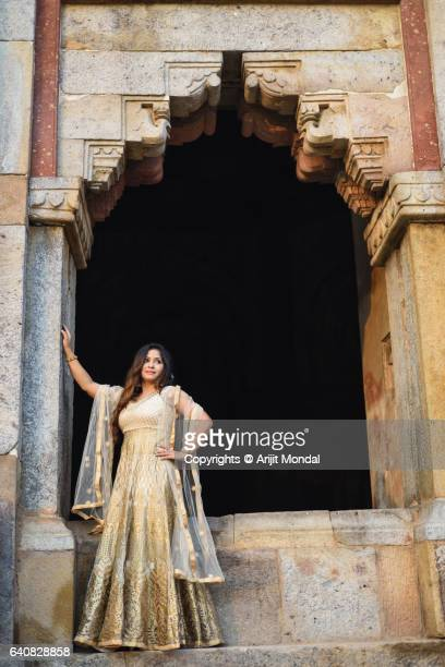 Full Length Photo of an Indian Woman Standing front of a Historical Monument Shisha Gumbad at Lodhi Gardens with Traditional Ethnic Clothing