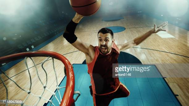 full length portrait of a basketball player with ball - making a basket scoring stock pictures, royalty-free photos & images