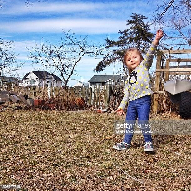 full length portrait of a girl standing on yard - mcconnell stock pictures, royalty-free photos & images