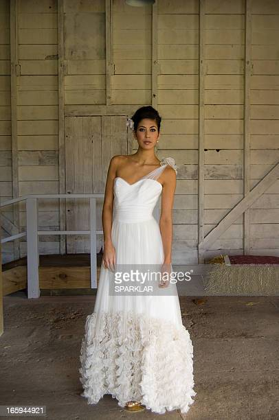 full length portrait of a model in a white gown - editorial stock pictures, royalty-free photos & images