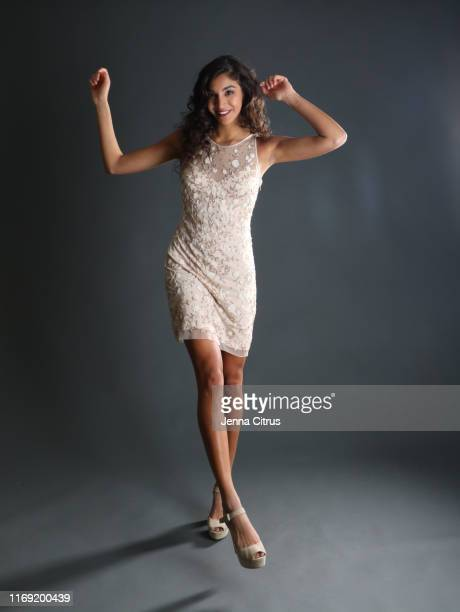 full length portrait of a woman arms raised in a white dress wearing high heels - lace dress stock pictures, royalty-free photos & images