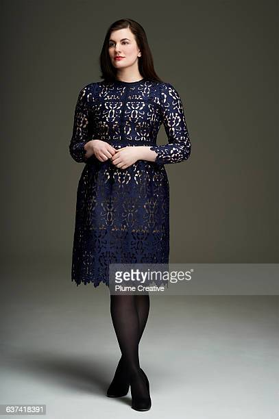 full length portrait of a woman in a blue dress - blue dress stock pictures, royalty-free photos & images