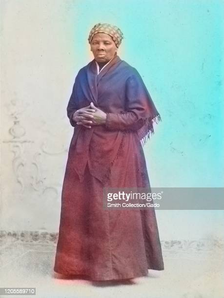 Full length portrait of activist Harriet Tubman in shawl with hands crossed, 1885. Courtesy Library of Congress. Note: Image has been digitally...