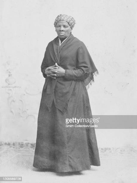 Full length portrait of activist Harriet Tubman in shawl with hands crossed, 1885. Courtesy Library of Congress.