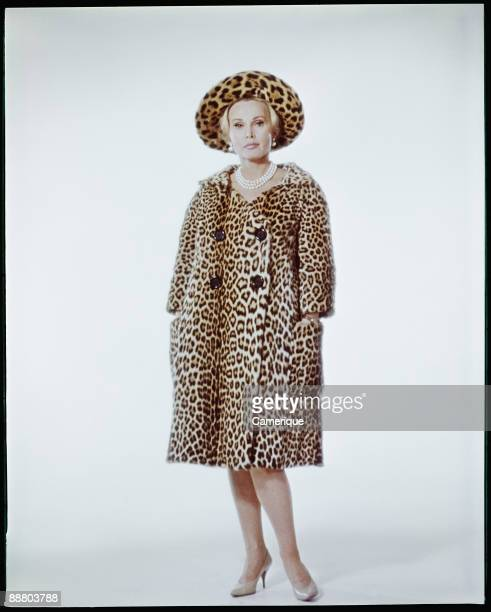 Full length portrait of actress Zsa Zsa Gabor in a leopard print hat and coat ca1960s