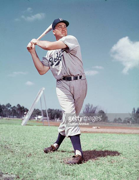 Full length portrait of American baseball player Duke Snider, sporting a Brooklyn Dodgers uniform and standing in a batting pose, circa 1955.