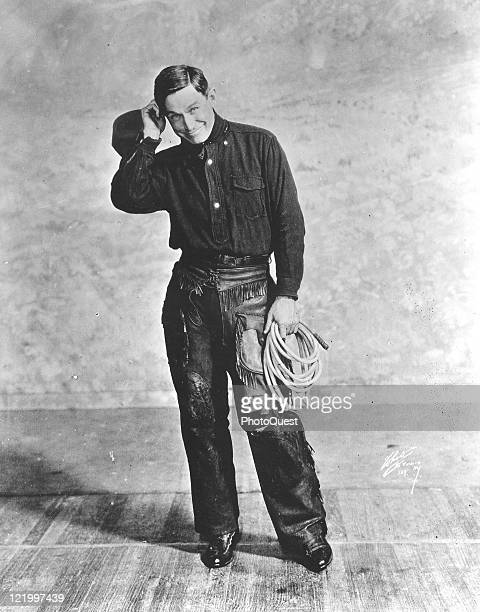Full length portrait of American humorist Will Rogers dressed in his cowboy garb early twentieth century
