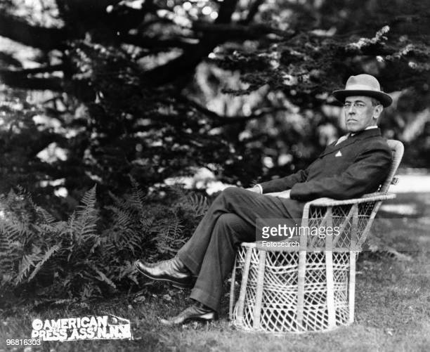 Full length portrait of American President Woodrow Wilson seated outdoors circa 1920