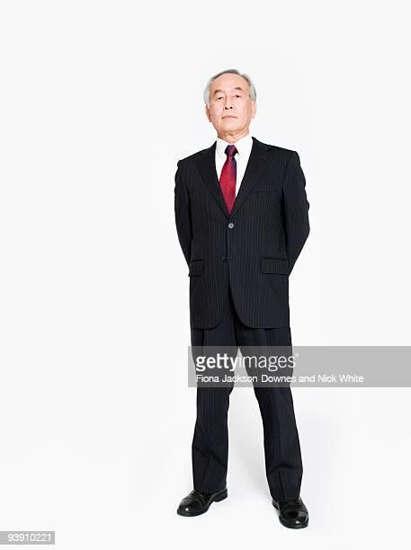 A full length portrait of an Asian man