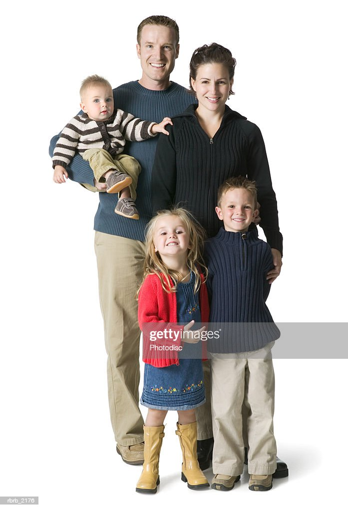 full length portrait of an attractive family of parents and three children : Foto de stock