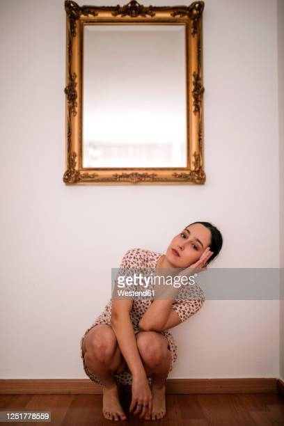 full length portrait of ballerina performing dance under classic mirror on wall at home - dancing photos et images de collection