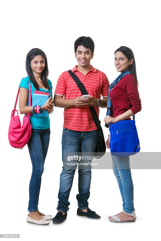 full length portrait of college students with books and bags against