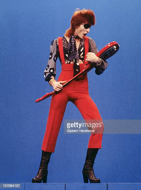 Full length portrait of David Bowie performing on the Dutch TV show TopPop playing the song 'Rebel Rebel' and wearing an eye patch on 7th February...